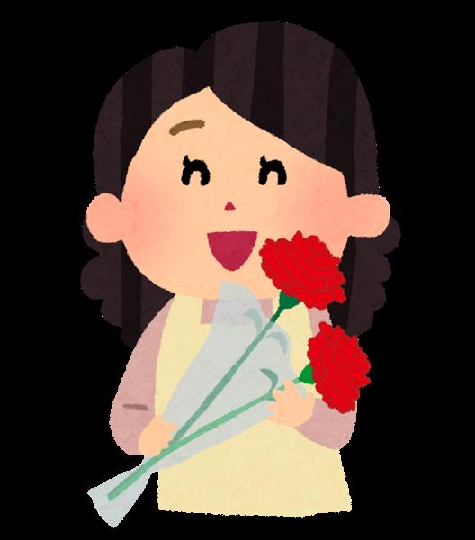 カーネーションの花束を持っている女性