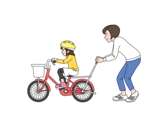 自転車の練習をしている親子