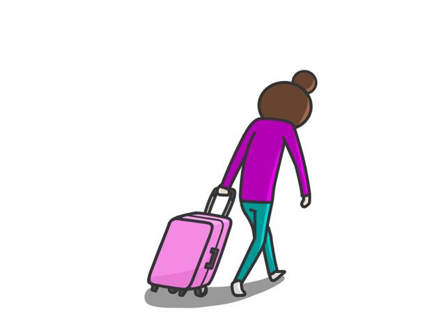 スーツケースを持ち歩いている女性