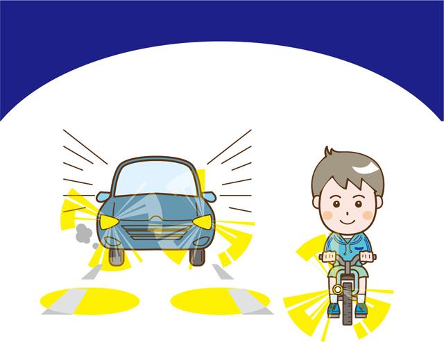 灯火している車と自転車